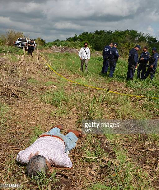 The dead body of Mexican journalist Humberto Millan Salazar lies on a field in the outskirsts of Culiacan Mexico on August 25 2011 Salazar an online...