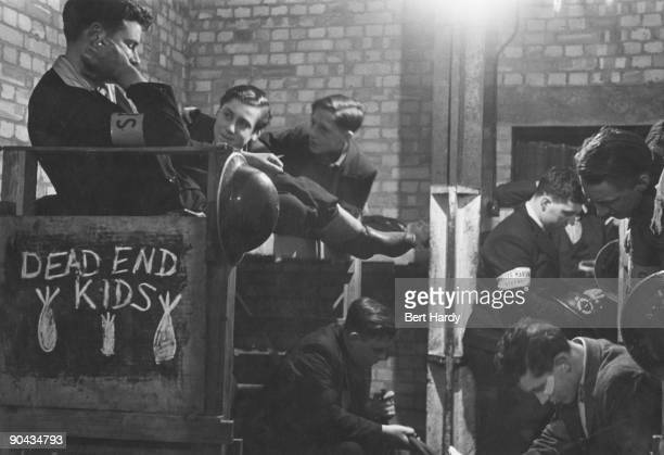 The 'Dead End Kids' are assembled in their annexe of the public air raid shelter at Watson's Wharf Stepney London April 1941 The boys are part of a...