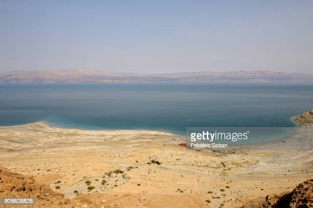 The Dead Sea, also called the Salt Sea, is a salt lake bordering Jordan to the east and Israel and the West Bank to the west on May 22, 2014 in...