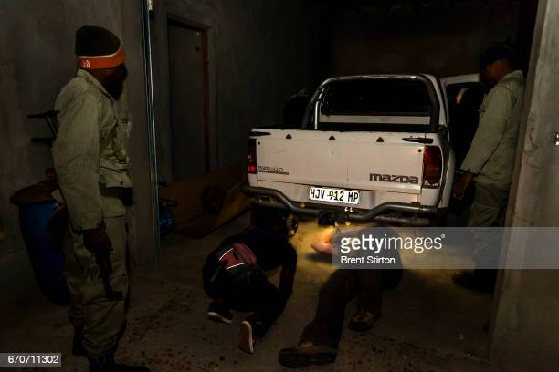 Mozambican PIC Police Garda Frontier and FAuna Bravia search a new home of a suspected high level weapons provider for illegal Rhino poaching They...