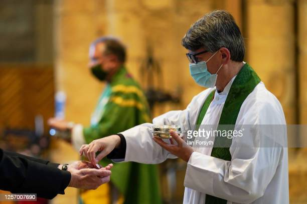 The Dean of Durham, The Very reverend Andrew Tremlett preaches during a Eucharist service at the first public worship held since Coronavirus...