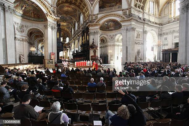 The Dean of St Paul's, the Rt Rev Graeme Knowles , conducts a mass in St Paul's Cathedral as it reopens for worshipers on October 28, 2011 in London,...
