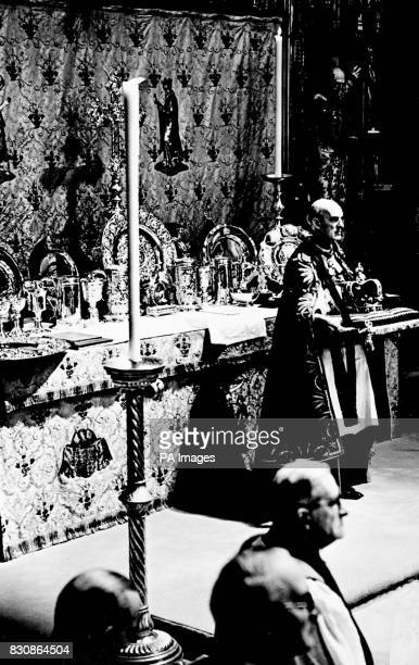 The Dean of Westminster is seen before the alter in the Abbey holding the St Edward's Crown which the Archbishop of Canterbury will take from him to...