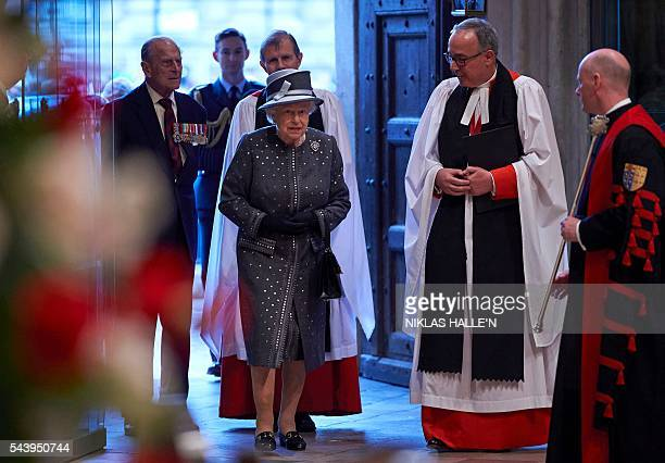 The Dean of Westminster Very Reverend Dr John Hall Britain's Queen Elizabeth II and Britain's Prince Philip Duke of Edinburgh arrive to attend a...