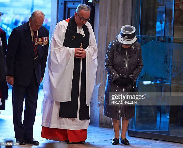 The Dean of Westminster Very Reverend Dr John Hall Britain's Queen Elizabeth II and Britain's Prince Philip Duke of Edinburgh bow as they leave after...