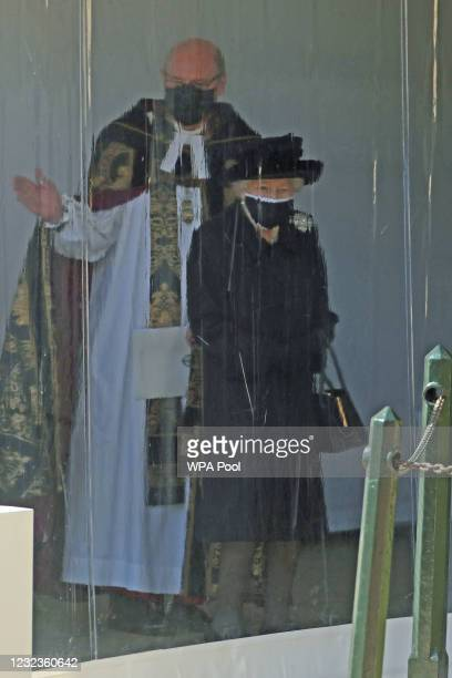 The Dean of Windsor and Queen Elizabeth II follow the procession at the Galilee Porch at St George's Chapel during the funeral of Prince Philip, Duke...