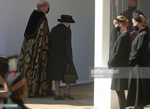 The Dean of Windsor, Queen Elizabeth II, Lady Louise Windsor and Countess of Wessex follow the procession at the Galilee Porch at St George's Chapel...