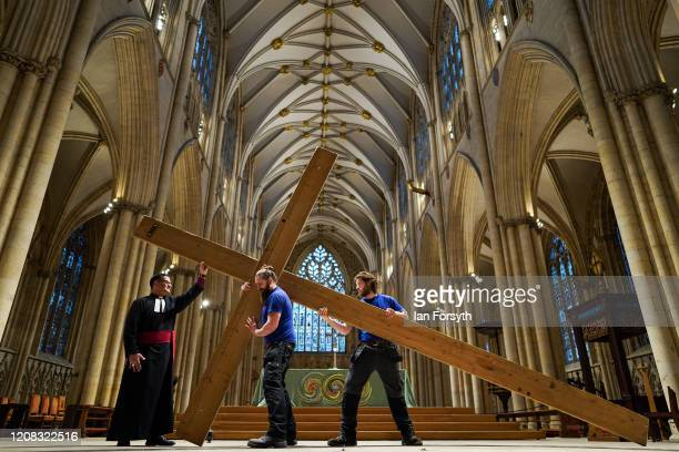 The Dean of York The Right Reverend Dr Jonathan Frost and members of the Minster's Works Department pose with a cross as they attend a media call as...