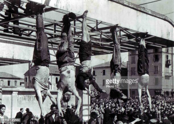 The death of Benito Mussolini the Italian fascist dictator body of Mussolini next to Clara Petacci and other executed fascists in Piazzale Loreto...