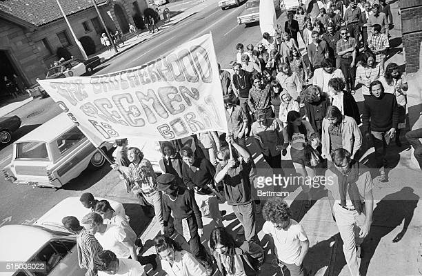 The Death of the Hippie San Francisco California A bearded long haired hippie carries an immense cross during a funeral procession proclaiming the...