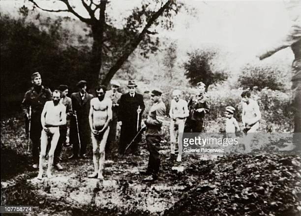 The Death Pit One of the most widely reproduced photos of a massacre in Eastern Europe showing an execution possibly by members of a German...