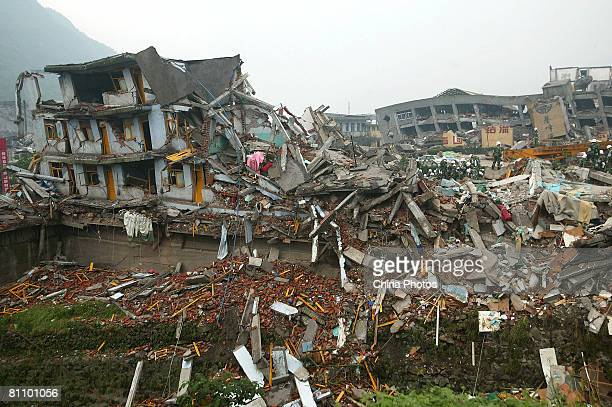 The debris of a collapsed plant are searched for victims in the Ronghua Township May 15, 2008 in the outskirts of Shifang, one of the hard-hit...
