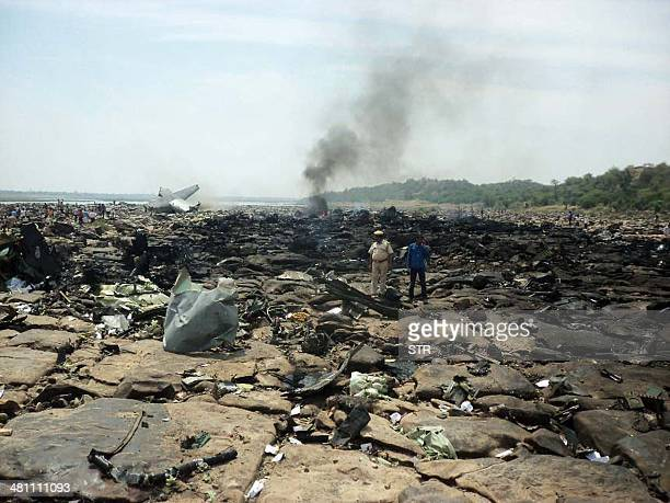 The debris of a crashed C130J Hercules cargo plane smoulders on the outskirts of Gwalior city in central Madhya Pradesh state on March 28 2014 A new...