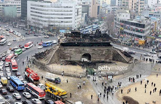 The debris of the Namdaemun gate following a fire is seen in central Seoul on February 11 2008 One of South Korea's most historic landmarks the...
