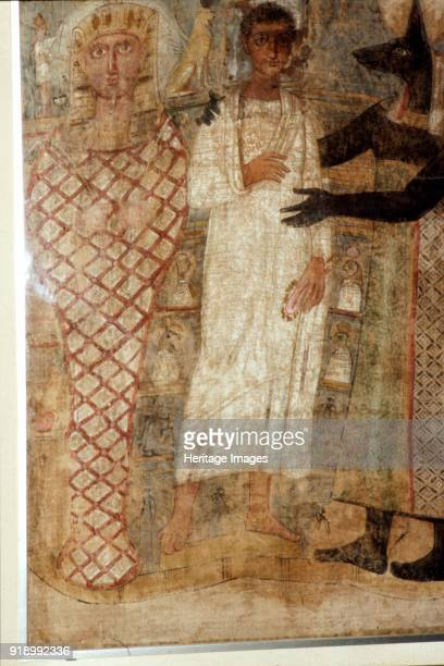 The Deceased and his Mummy protected by Anubis Egypt 3rd century Encaustic painting on linen At Louvre Artist Unknown