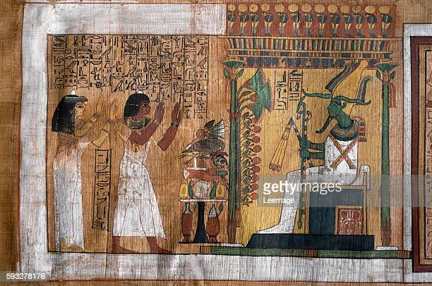 The deceased Kha and his wife Merit worship Osiris lord of the afterlife Papyrus from Book of the Dead from the funerary chamber of architect Kha...