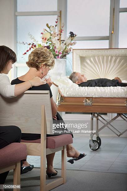 The Deceased Laying In A Coffin At A Funeral