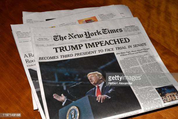 The December 19, 2019 edition of The New York Times with a headline 'Trump Impeached'.