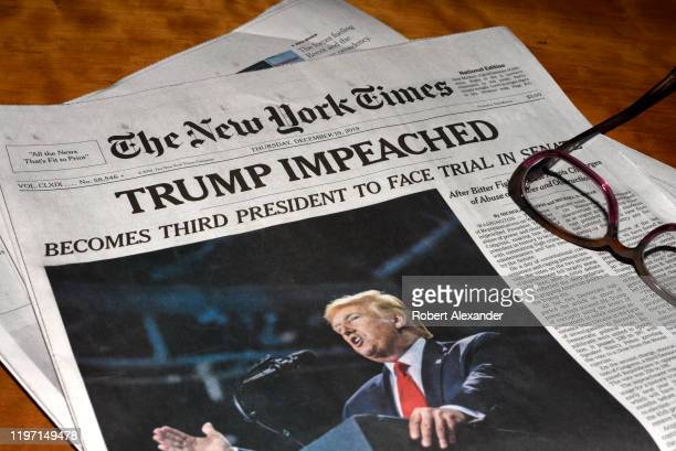 The December 19 2019 edition of The New York Times with a headline 'Trump Impeached'