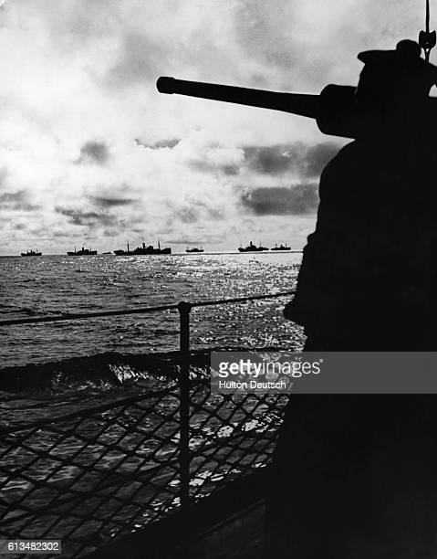 The deck of a French warship among a convoy of merchant ships in the Atlantic.