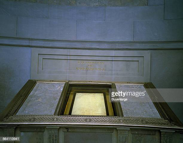 The Declaration of Independence displayed in a dimly lit hall at the National Archives reserved for the original Charters of Freedom Washington DC