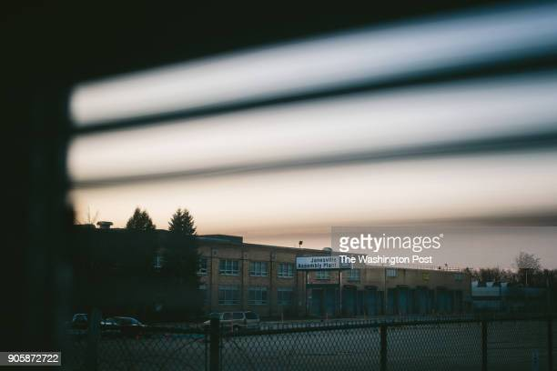 The decommissioned Janesville GM Assembly Plant is scene through a window at the Zoxx 411 ClubAmy Goldstein excerptJanesville Wisconsin lies three...