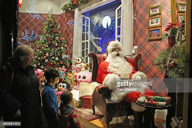 The decorated Christmas shop windows of Hamleys on Regent Street on December 15 2014 in London England Many prominent retailers in the capital have...