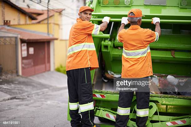 the dedicated garbage collectors - street sweeper stock pictures, royalty-free photos & images