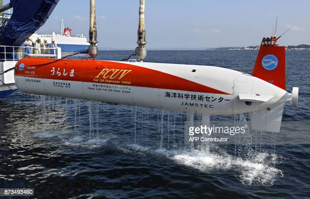 The deepsee cruising AUV Urashima is lifted by its mother ship after preliminary tests at the Japan Marine Science and Technology Center in Yokosuka...