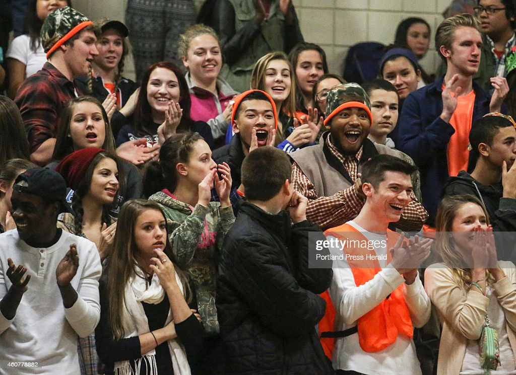 The Deering High School student section cheers as guard ...