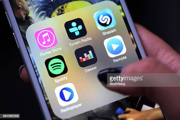 The Deezer music mobile app centre sits amongst other music apps on an Apple Inc iPhone 6 in this arranged photograph in London UK on Tuesday Aug 18...