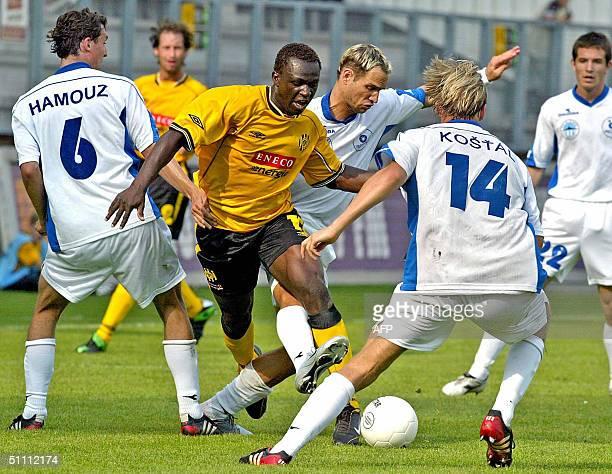 The defence of Slovan Liberec gets in the way of Kerkrade Roda JC's Arouna Kone 24 July 2004 in Kerkrade. The match ended tied 1-1.