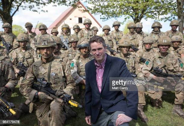 The Defence Secretary Gavin Williamson poses for a group photograph with British troops at a live demonstration at the Joint Expeditionary Force Live...