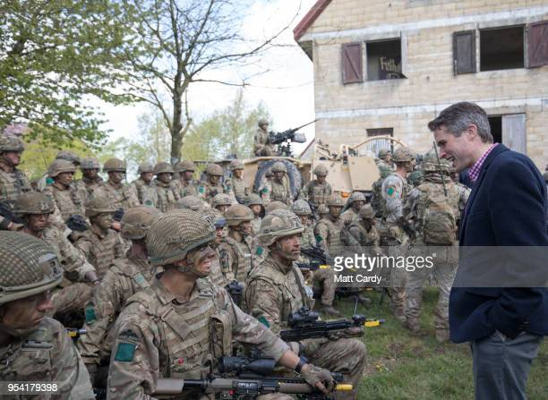 The Defence Secretary Gavin Williamson talks with British troops at a live demonstration at the Joint Expeditionary Force Live Exercise Distinguished...