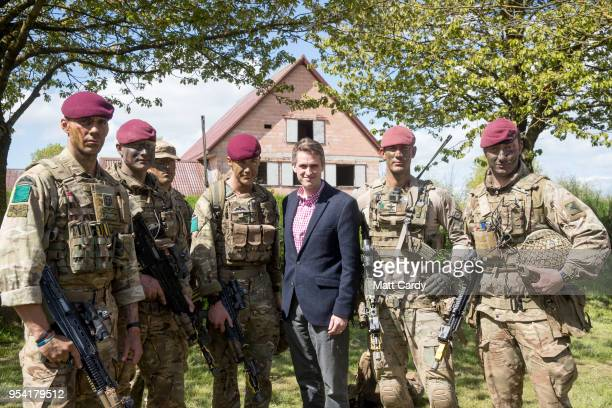 The Defence Secretary Gavin Williamson talks with troops at a live demonstration at the Joint Expeditionary Force Live Exercise Distinguished Visitor...