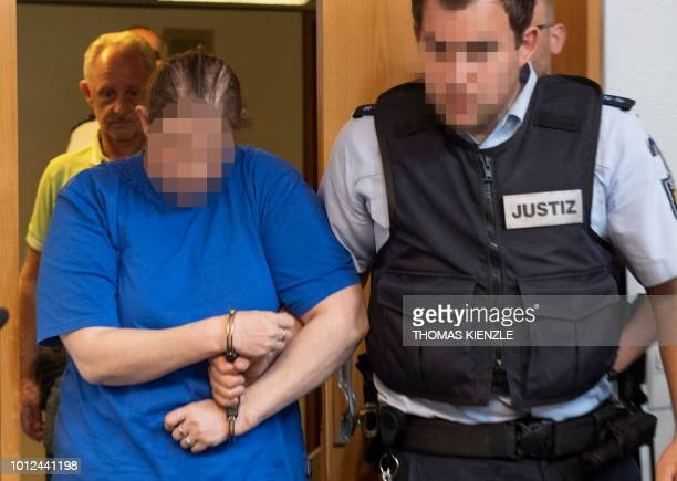 The defendant Berrin T is led to the courtroom of the district court in Freiburg southern Germany on August 7 2018 Berrin T and Christian L both...
