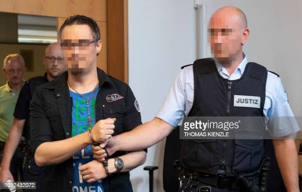 The defendant Christian L enters the coourtroom prior to the pronouncement of sentence at the district court in Freiburg southern Germany on August 7...