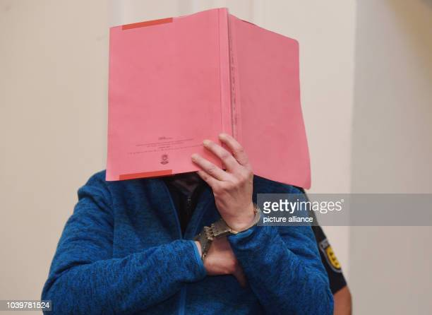 The defendant in the Antonella B murder trial waits for sentencing to begin in a hearing room at the district court in Karlsruhe Germany 16 October...