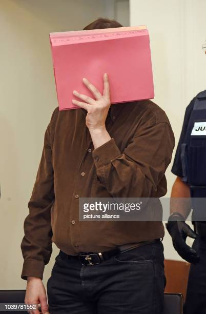 The defendant in the murder trial of Antonella B waits for the start of trial in a courtroom at the regional court in Karlsruhe Germany 06 October...