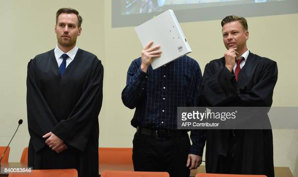 The defendant Philipp K and his lawyers David Muehlberger and Sascha Marks wait in a court room at the country court in Munich southern Germany on...