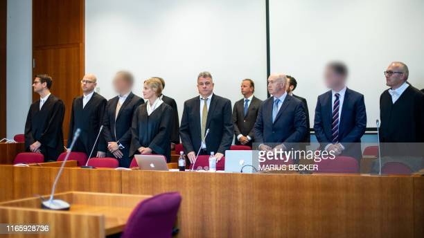 The defendants stand together with their lawyers interpreters and representatives of different banks on September 4 2019 at the district court in...