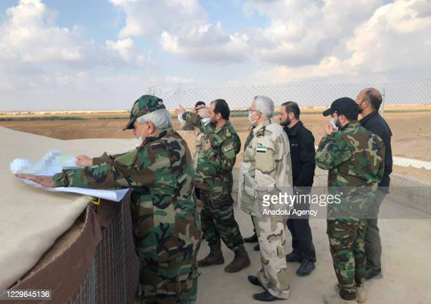 The Defense Ministry delegation led by Syrian Interim Government's Defense Minister Salim Idris inspect an area during their visit to Tal Abyad Syria...
