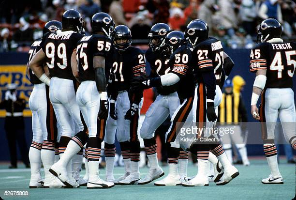 The defense of the Chicago Bears huddles prior to the next play during a game on December 14 1985 against the New York Jets at Giants Stadium in East...