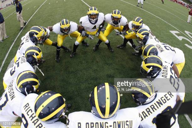 The defensive backs for Michigan huddle up prior to action between the Michigan Wolverines and Indiana Hoosiers at Memorial Stadium in Bloomington...