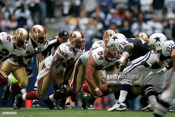 The defensive line of the San Francisco 49ers lines up during an NFL football game against the Dallas Cowboys at Texas Stadium on November 23 2008 in...