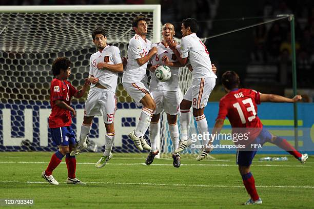 The defensive wall with Isco Koke Oriol Romeu and Recio of Spain stop the free kick from Lee Ki Je of Korea Republic during the FIFA U20 World Cup...
