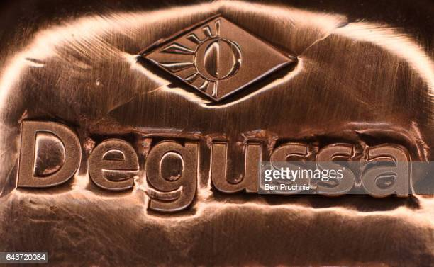 The DEGUSSA logo is stamped on 1000g block of rose gold at Sharps Pixley Bullion Brokers on December 15 2015 in London England The brand established...