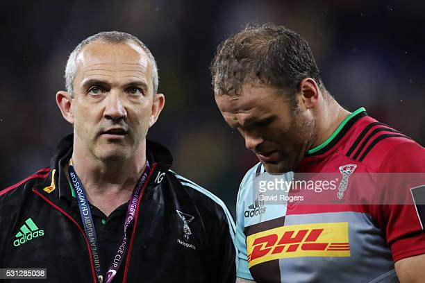 The dejected Conor O'Shea the Harlequins Director of rugby and Jamie Roberts of Harlequins look on folloowing their team's 2619 defeat during the...
