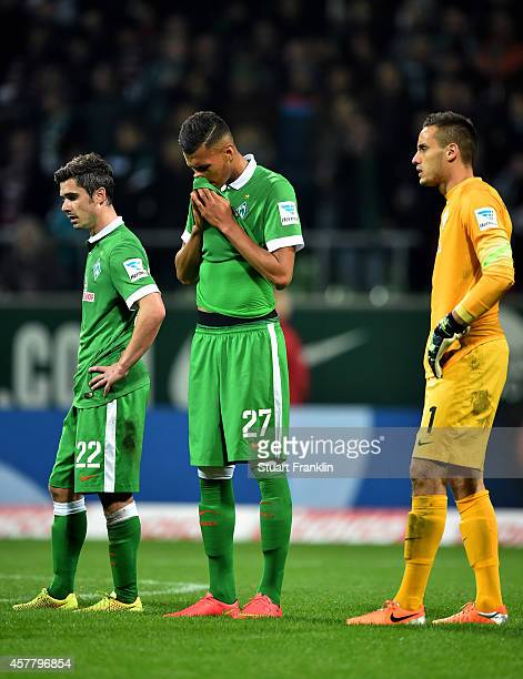 The dejected Fin Bartels, Davie Selke and Raphael Wolf of Werder Bremen react following their team's 1 -0 defeat during the Bundesliga match between...