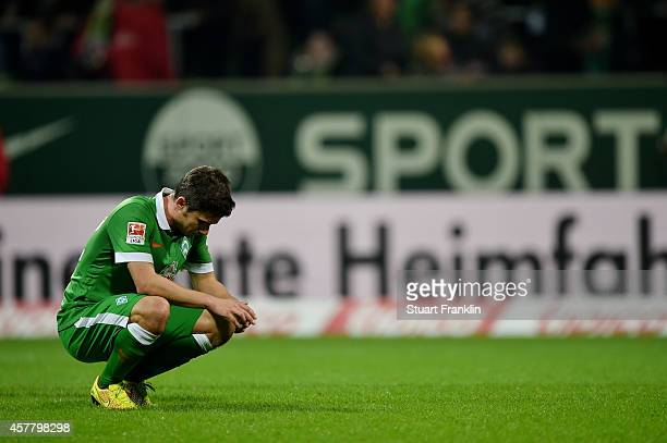 The dejected Fin Bartels of Werder Bremen reacts following his team's 10 defeat during the Bundesliga match between SV Werder Bremen and FC Koeln at...